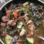 Bowl of Kale Soup with white beans and sausage.