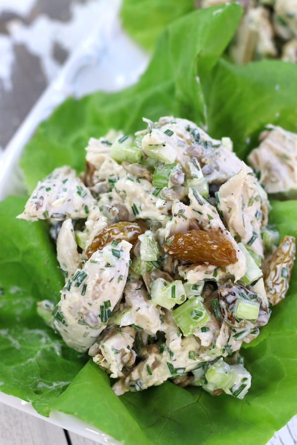A scoop of Shredded Chicken Salad Recipe with tarragon, sunflower seeds, chives and celery.