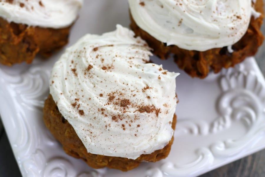 Iced Pumpkin Cookies sprinkled with ground cinnamon.