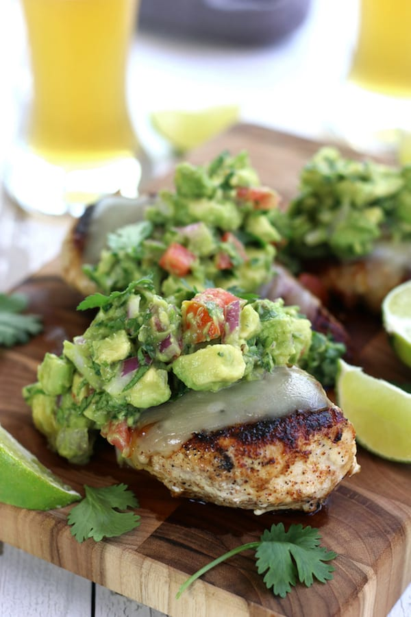 Three Pan Seared Chicken breast topped with Simple Healthy Guacamole.