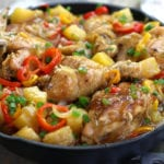 Sweet and Sour Chicken Recipe with whole chicken pieces in a cast iron skillet.