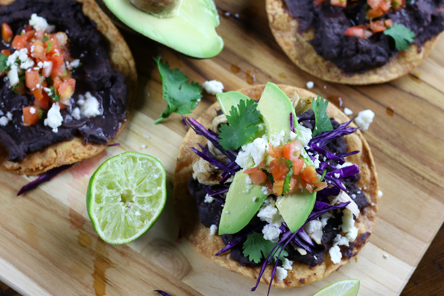 Overhead photo of Black Bean Tostadas with several different toppings.