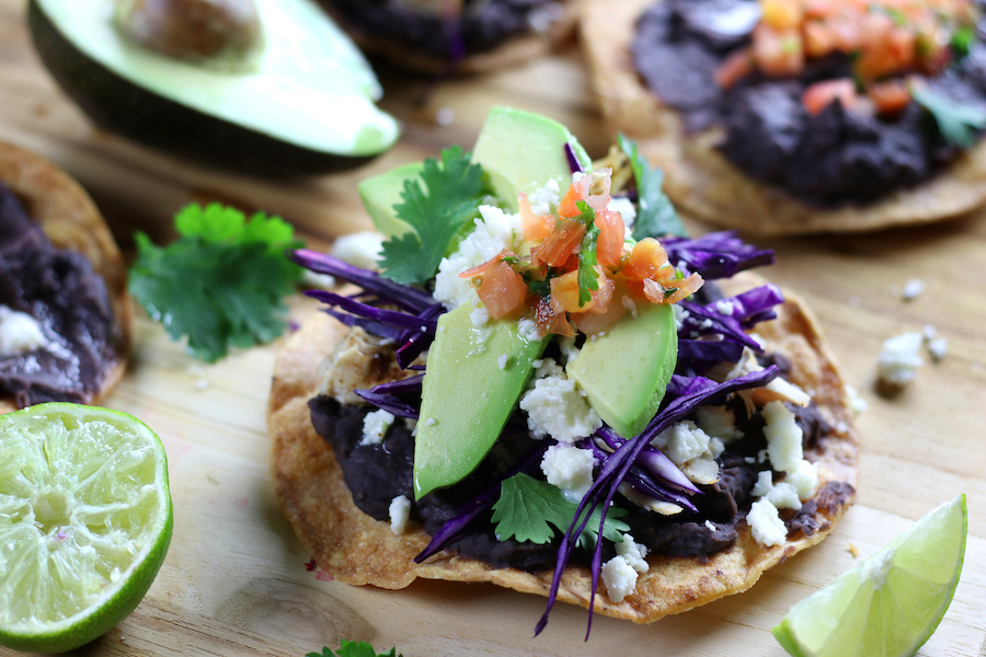 Side view of fully dressed Chicken Tostadas.