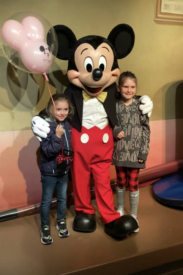 Mickey Mouse with two little girls from Disneyland Day Trip.