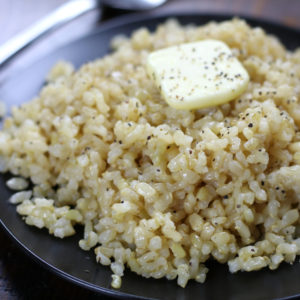 Healthy Rice Recipe that is cooked on a black plate.
