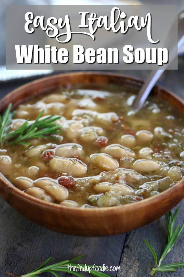 Italian White Bean Soup tastes like you slaved over a stove all day but it is an easy soup that comes together in just about 30 minutes. Made with cannellini beans, bacon, rosemary and garlic. This soup is quick, easy and tastes amazing. #WhiteBeanSoup #EasyBeanSoup #TuscanWhiteBeanSoup #QuickBeanSoup https://www.thefedupfoodie.com