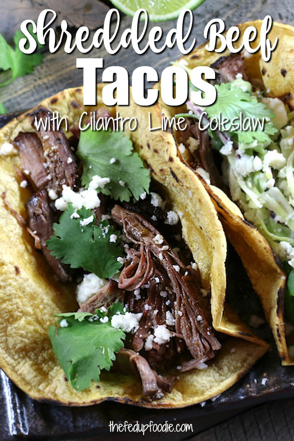 Shredded Beef Tacos with Cilantro Lime Coleslaw has flavorful melt in your mouth Mexican Shredded Beef. Paired with a crunchy cabbage slaw, this dinner is easy to make and fun to eat!