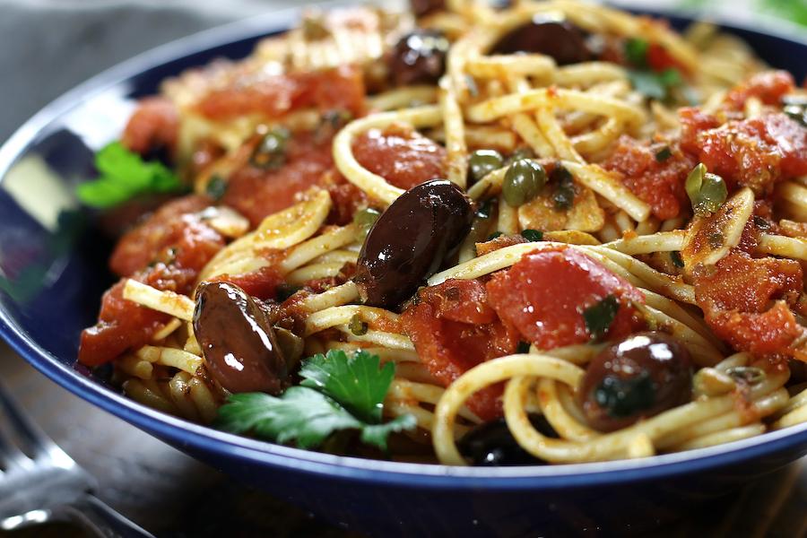 Alla Puttanesca sauce with spaghetti noodles.