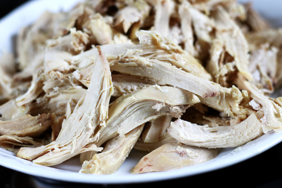 Platter full of shredded chicken from Easy Boiled Chicken recipe.