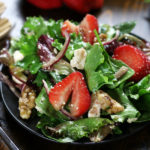Green Salad with Strawberries, walnuts and spring mix.