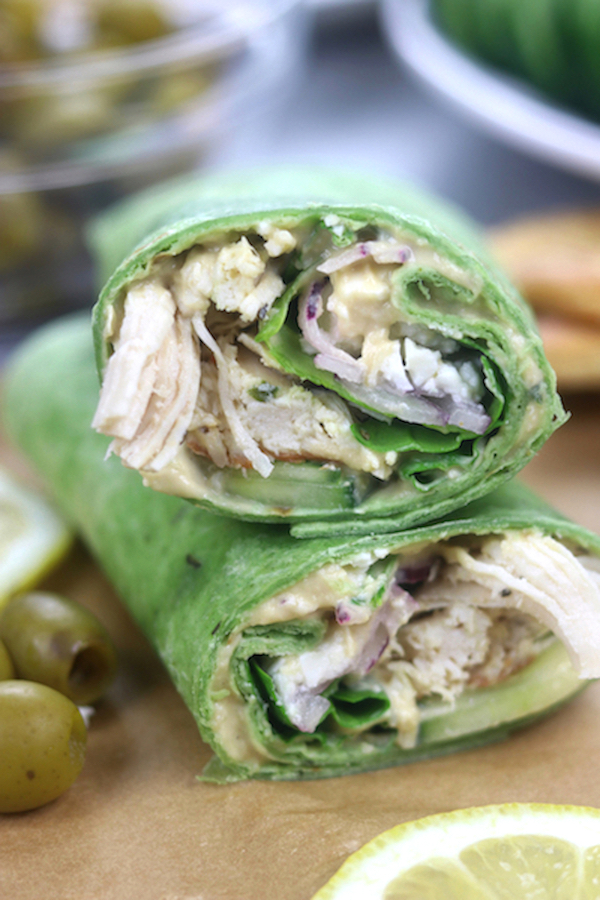 Instant Pot Greek Chicken Wraps cut in half with the two halves sitting on top of each other.
