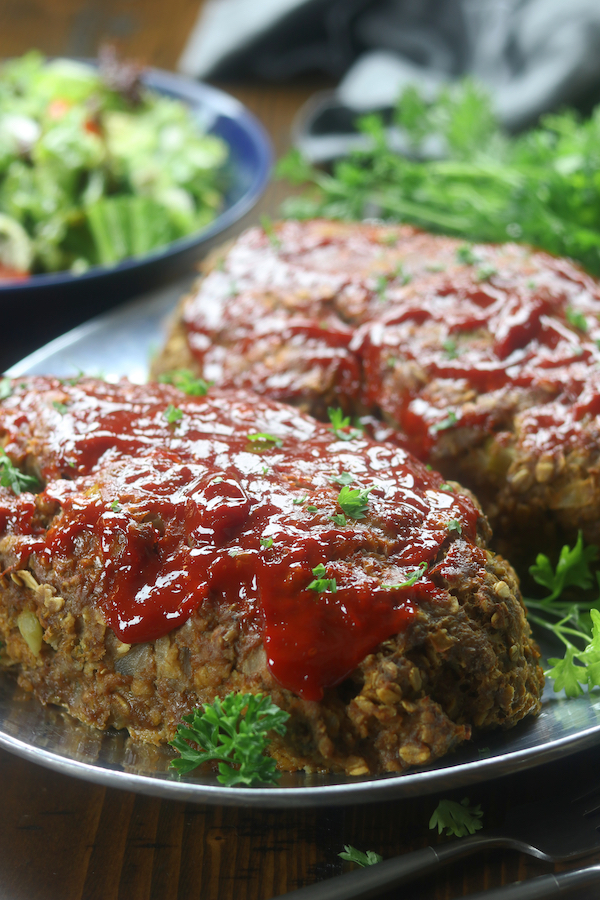 Two meatloafs on a silver platter from Mom's Classic Meatloaf recipe.
