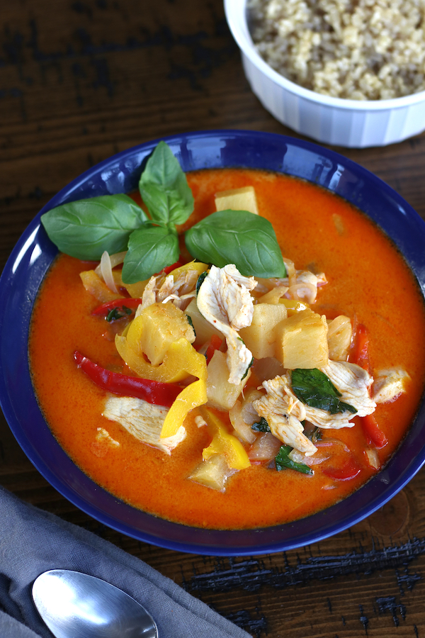 Pineapple Curry with chicken and bell peppers in a blue bowl.