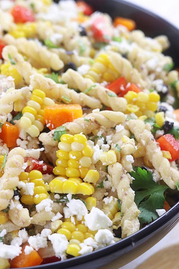 A large serving bowl of Southwest Pasta Salad.