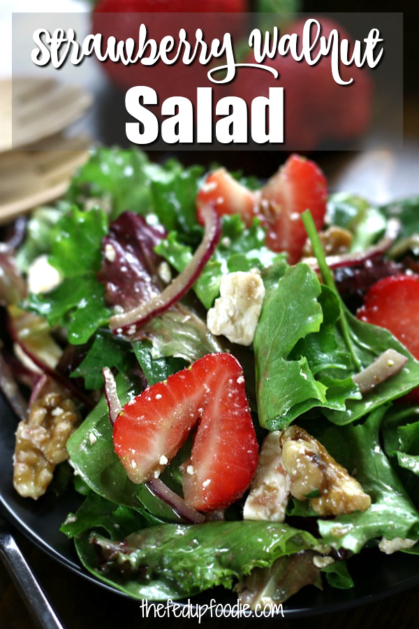 Sweet strawberries, toasted walnuts, tangy feta, spring mix salad and a simple balsamic vinaigrette are tossed together to make an irresistible Strawberry Walnut Salad. This salad comes together quickly and is a perfect addition to all kinds of get togethers.  #StrawberryWalnutSalad #SpringMixSalad #StrawberrySalad https://www.thefedupfoodie.com