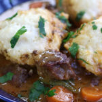 Up close photo of a serving of Beef Stew and Dumplings.