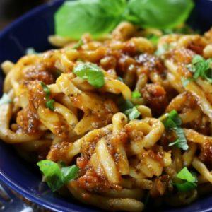 Pici All'Aglione Recipe (Tuscan Pasta with Tomato-Garlic Sauce in a blue serving bowl.