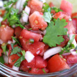 Pico de Gallo in a clear glass bowl.