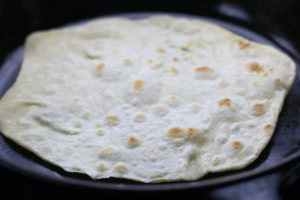 Cooking the Second Side of a Homemade Flour Tortilla