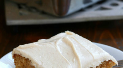 Up close photo of a slice of Apple Sauce Spice Cake.