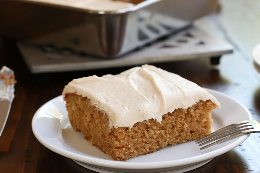 Fluffy Applesauce Cake Recipe topped with cinnamon cream cheese.
