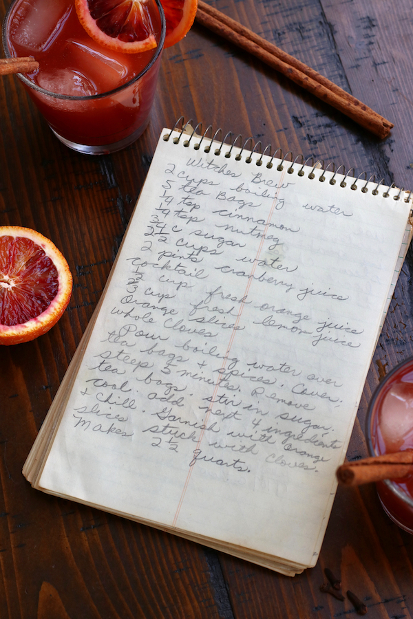 Handwritten Witches Brew Punch written on a spiral notebook.