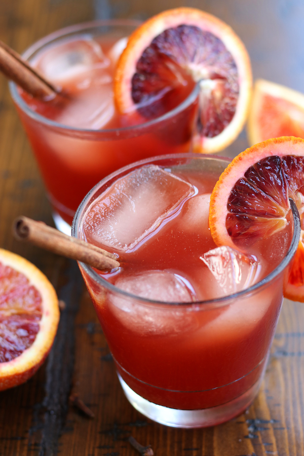 Witches Brew Recipe served into clear glasses and garnished with blood orange slices.