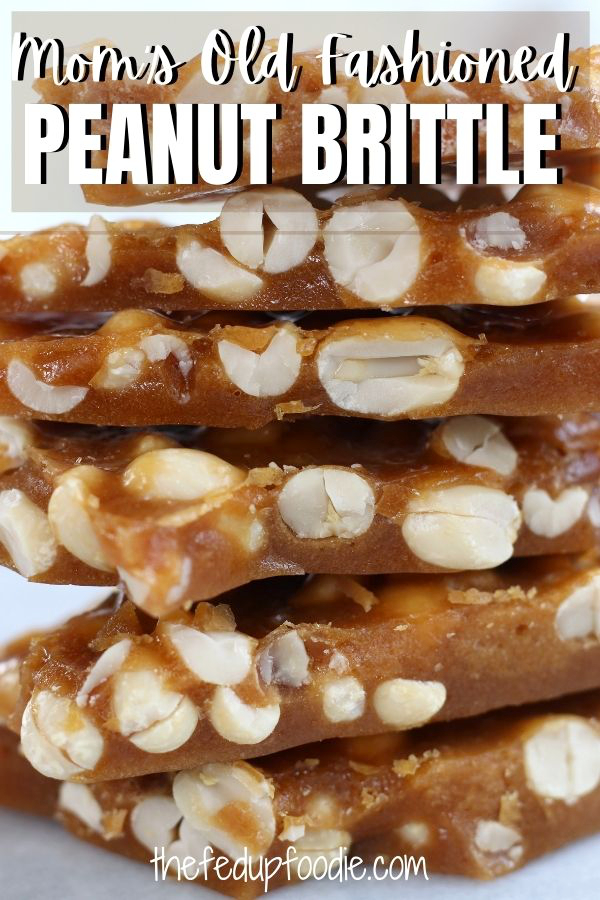 The BEST Peanut Brittle Ever! Mom's Old Fashioned Peanut Brittle recipe is so easy to make. With these simple steps this peanut candy turns out perfect every time. Buttery, crisp and absolutely heavenly.