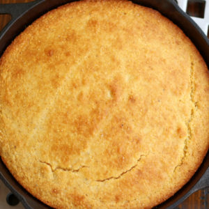 Overhead photo of Skillet Corn Bread sitting on long trivet.