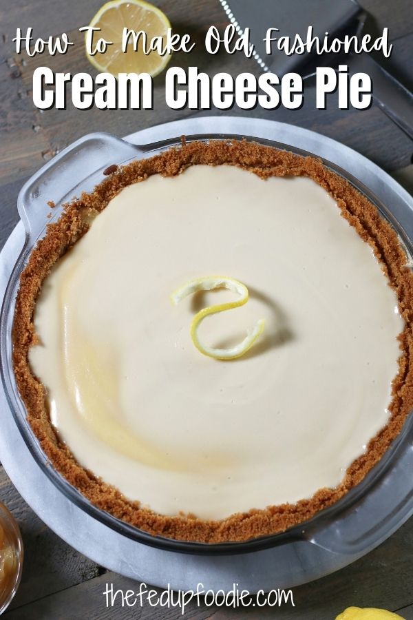 Extra smooth and creamy, Old Fashioned Cream Cheese Pie is an amazing Icebox Pie.  With a graham cracker crust and sweetened sour cream topping, this easy pie is perfect for the Holidays or as a summertime dessert. 