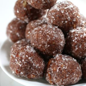 A pile of Chocolate Rum Balls rolled in sparkling sugar.