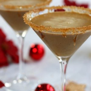 Two Gingerbread Martinis sitting on a white table.