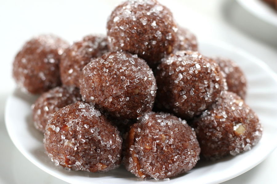 No Bake Rum Balls sitting on a white plate.