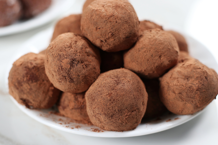 A plate of Old Fashioned Rum Balls served on a plate.