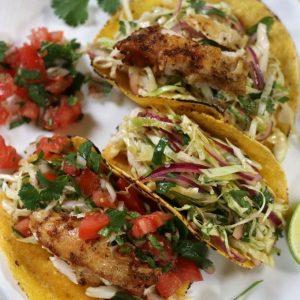 Three Baja Chicken Tacos on white plate.