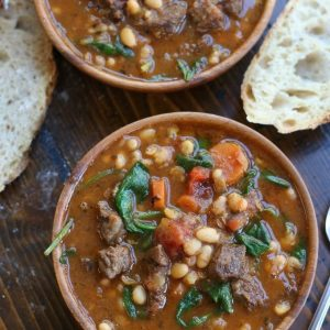 Two wooden bowls of Beef and Bean Stew.