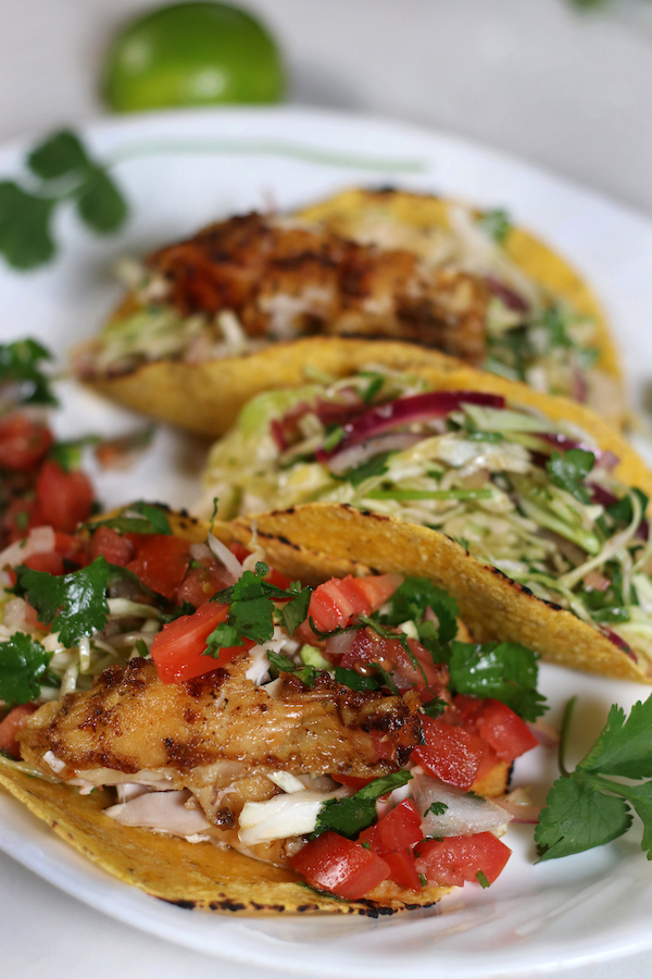 Chicken Tacos with corn tortillas and crispy marinated and baked chicken.