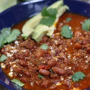 Chorizo Pinto Bean Soup in a blue serving bowl.