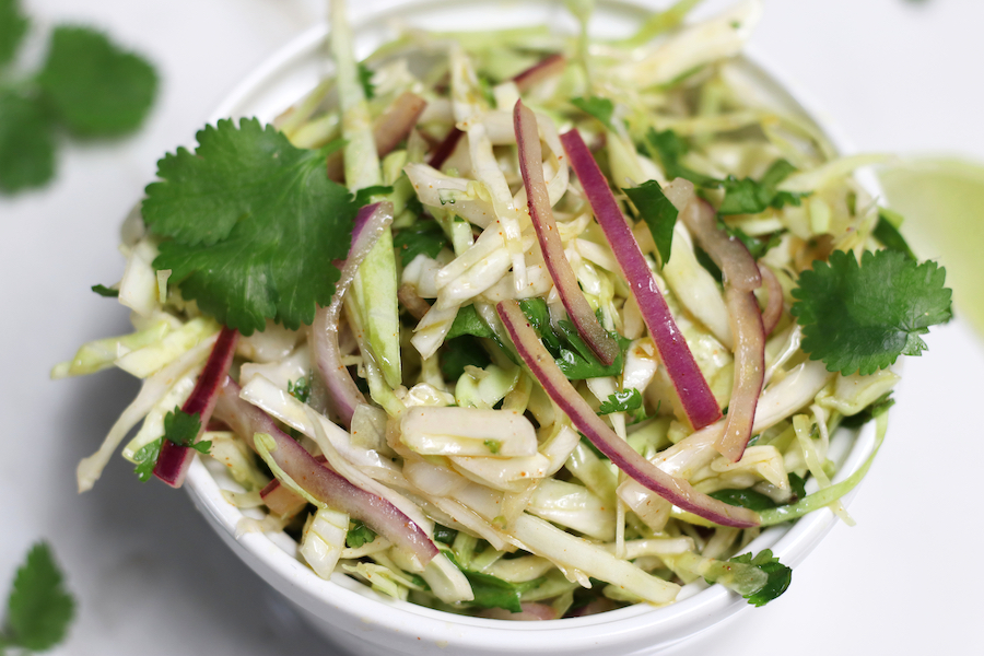 Overhead photo of a bowl of Cilantro Lime Coleslaw with no Mayo.