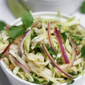 Up close photo of Mexican Coleslaw with Cilantro Lime Dressing.