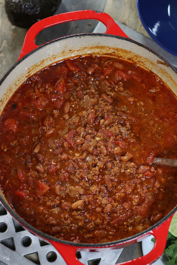 Overhead photo of a red pot of Pinto Bean Soup Recipe.