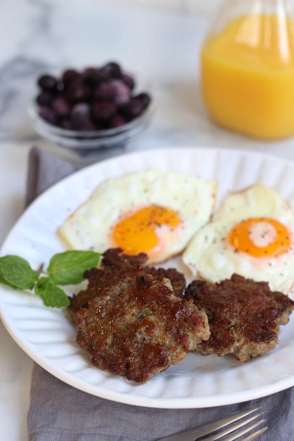 Morning Breakfast scene with Hearty Breakfast Sausage, eggs and orange juice.