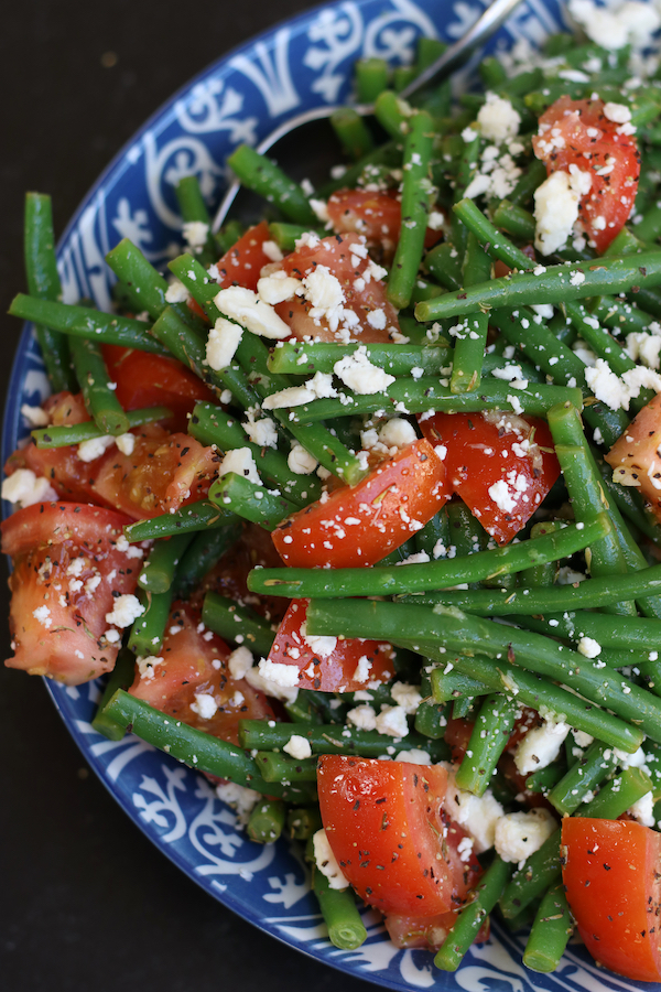 Green Bean Tomato Salad in a blue and white patterned bowl.