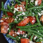 An up close photo of Green Bean and Tomato Salad.