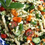 Cold Pasta Salad for summertime in a blue and white bowl.