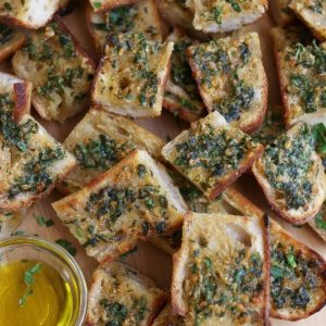 Slices of Sourdough Garlic Bread piled on top of each other.