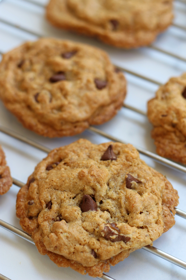 Vegan Chocolate Chip Cookies with Applesauce cooling on a rack.