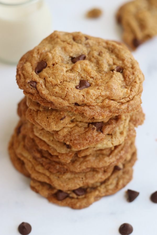 Seven Vegan Oatmeal Chocolate Chip Cookies stack on top of each other.