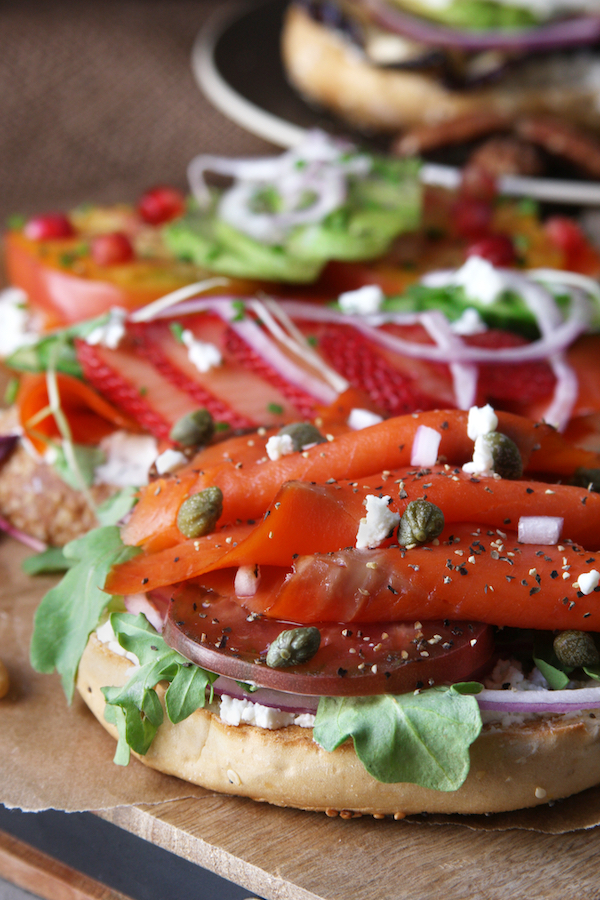 Lox Bagel with heirloom tomato slices, capers and arugula.