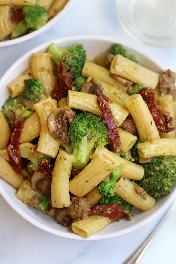 Overhead photo of a bowl of Sausage and Pesto Pasta.